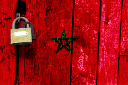 Morocco flag is on texture. Template. Coronavirus pandemic. Countries may be closed. Locks.