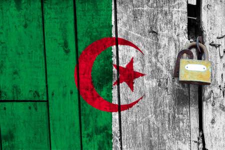 Algeria flag is on texture. Template. Coronavirus pandemic. Countries may be closed. Locks.