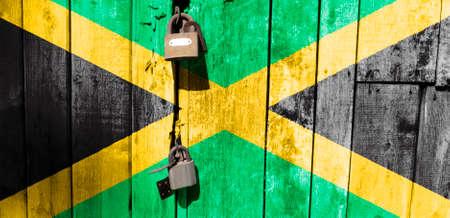 Jamaica flag is on texture. Template. Coronavirus pandemic. Countries may be closed. Locks.