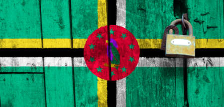 Dominica flag is on texture. Template. Coronavirus pandemic. Countries may be closed. Locks.