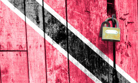 Trinidad and Tobago flag is on texture. Template. Coronavirus pandemic. Countries may be closed. Locks.
