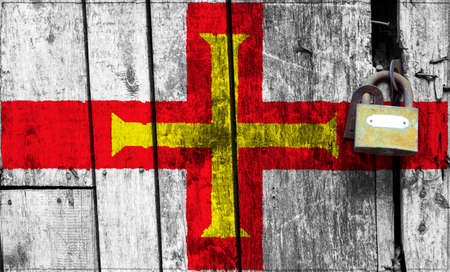 Guernsey flag is on texture. Template. Coronavirus pandemic. Countries may be closed. Locks.