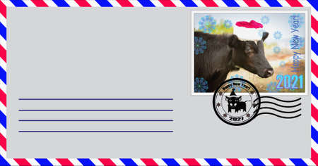 Blank mailing envelope with a stamp depicting a bull wearing a Santa Claus hat. Content for the designer.