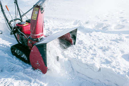 Tracked snow blower at work. After heavy snowfalls, snow is removed everywhere. 版權商用圖片