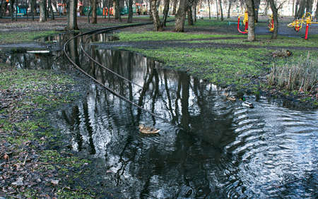 Spring. The snow melts, the water level in rivers and lakes rises. Flooding in the park. The tram rails are flooded with water.