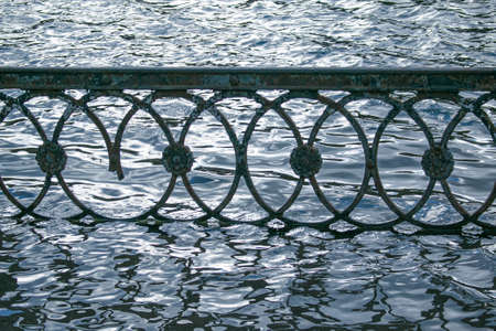 Spring. The snow melts, the water level in rivers and lakes rises. Flooding in the park. The embankment fences are flooded with water.