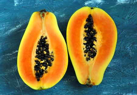 Papaya halves on a blue background