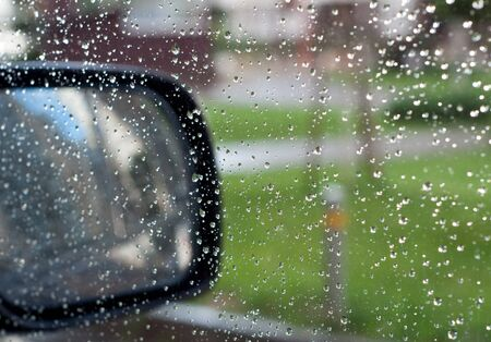 Raindrops on car glass during the day
