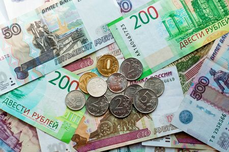 Money of Russia. Banknotes and coins. Close-up of Russian rubles of various denominations. Finance concept.