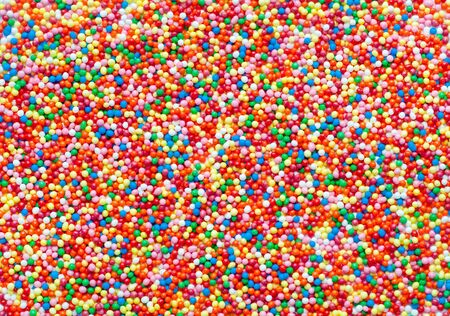 Abstract colorful sugar balls background.Used to decorate baking and sweets. Rainbow-colored sugar chips