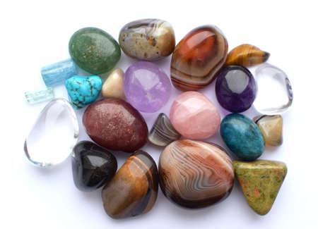Tumbled gems of various colors. Amethyst, rose quartz, agate, apatite, aventurine, olivine, turquoise, aquamarine, rock crystal.