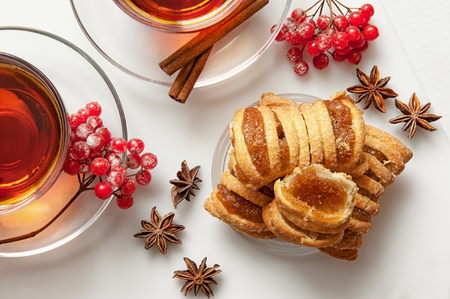 soumis: biscuit filled with marmalade with Kalina filed with tea on white background