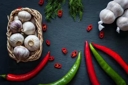 characteristic: garlic, pepper and herbs on the board slate Stock Photo