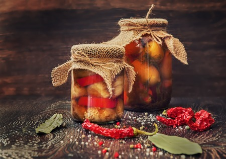 home products made of roasted eggplant in glass jars Stock Photo