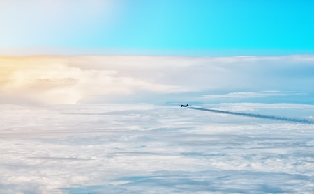 flight mode: Plane flying above the clouds in the early morning. The horizontal frame.