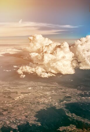 beautiful rare: View of clouds and land from airplane window from a height.