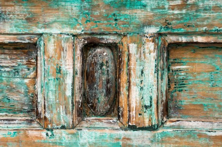 Abstract wooden textured background with cracks on the blue plaster paint. Blur. The horizontal frame.