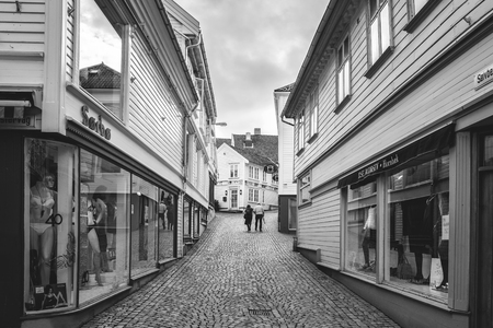 Norway, Stavanger, 07.30.2013 . Sad lonely elderly couple is on a deserted street . Black-and-white frame. The horizontal frame. Editorial