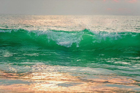 Beautiful high tide surf at sunset in the sun. The horizontal frame.