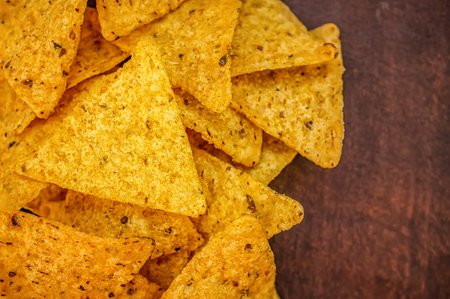 Background of corn tortillas or Nachos fried on open fire. Stock fotó
