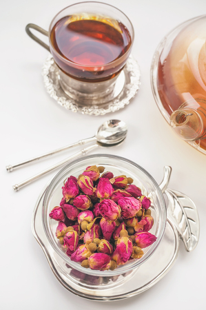 Dry rose buds for tea. Chinese tea from Yunnan. Bi Lo Chun. Copy the space. The view from the top. Selective focus. Banque d'images - 99033931