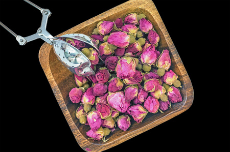 Dry rose buds for tea and dried and dried in hibiscus sugar. Chinese tea from Yunnan. Bi Lo Chun. Copy space. isolated