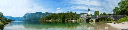 Reflection of the Holy spirit Church, lake Bohinj Slovenia. Panorama.