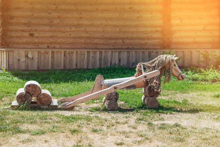 Wooden horse landscape design. Lovingly decorated the area with plants and flowers.
