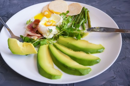 Poached egg with corn vegetables, grilled pepper, spinach, arugula, green beans and baby salad. Natural food. Scandinavian Breakfast