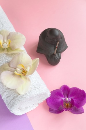 Beautiful soap in the form of flowers and towel with lavender flowers for Spa treatments on a two-tone background. Selective focus
