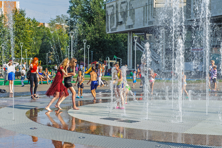 Russia, Yaroslavl August 04 2018 . Children swim in the street in the fountain in hot weather. Extreme heat