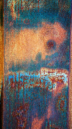 Original textured background of painted rusty galvanized metal with blue paint spots.