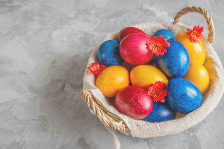 Colorful easter eggs lying in a basket on a beautiful vintage