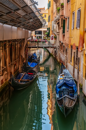 Venice, city of Italy. View of the canal, the Venetian landscape with boats and gondolas.