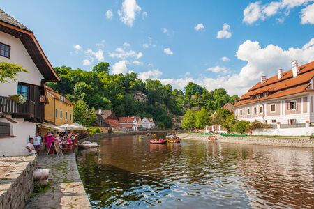 Cesky Krumlov, Czech Republic August 15 2017: beautiful view of a fragment of the embankment and the coastal area of the Vltava river. People produce rafting on the river. Editorial.