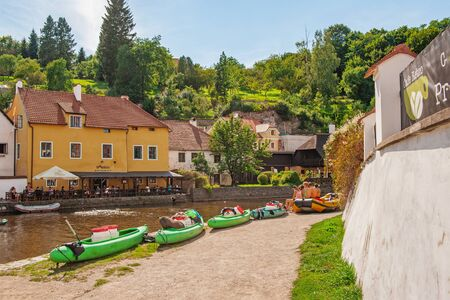 Cesky Krumlov, Czech Republic August 15 2017: beautiful view of a fragment of the embankment and the coastal area of the Vltava river.