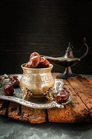 Dried date palm fruits or kurma, ramadan food. Beautiful bowl full of date fruits symbolizing Ramadan. Close -up.