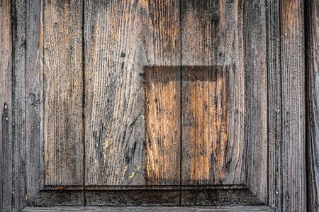 Background of old wooden boards with convex insert and wood. Wood texture.