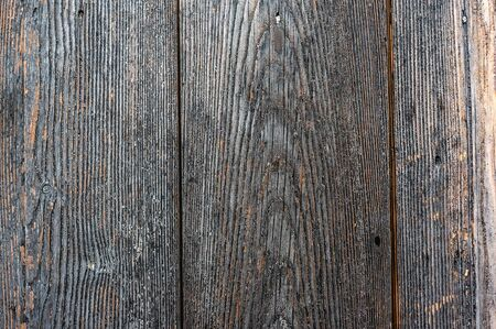 Texture of old wooden wet planks. Old vintage aged grunge dark brown and gray wooden floor planks.