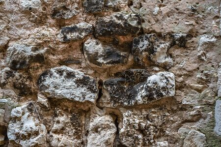 Original background of natural large stone on the wall with the texture of cracks and bricks . Stok Fotoğraf