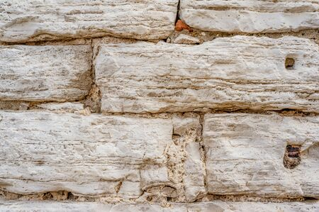 Original background of natural ancient large stone on the wall with the texture of cracks and bricks . Stok Fotoğraf