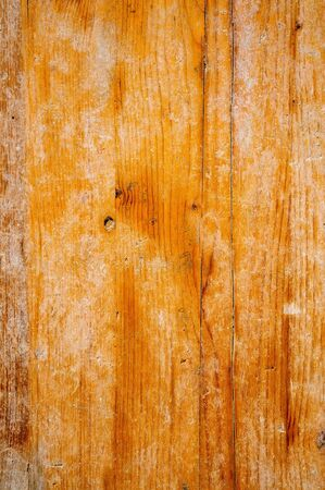 Original old background of natural yellow plywood with cracks.