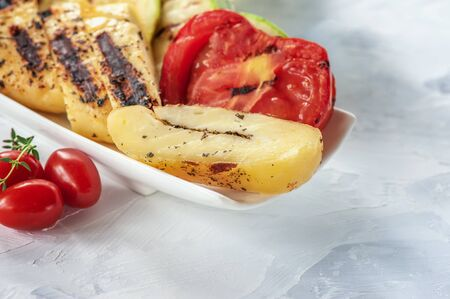 Slices of fried halloumi cheese with fried tomatoes. Traditional serving of halloumi cheese. Farm natural product.