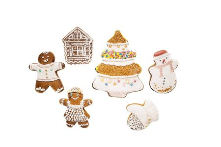 Glazed Christmas cookies, traditional gingerbread. Decorated with Christmas decorations.