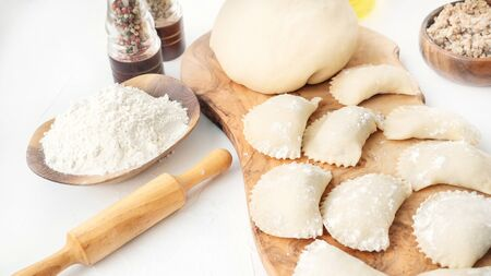 Cooking homemade dumplings from raw homemade dough. National cuisine of Slavic peoples. 스톡 콘텐츠