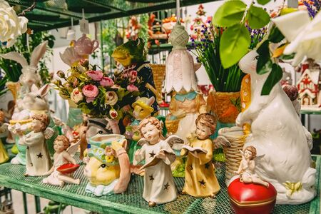 Showcase with Easter Souvenirs hares, dolls, bells in the store. 写真素材