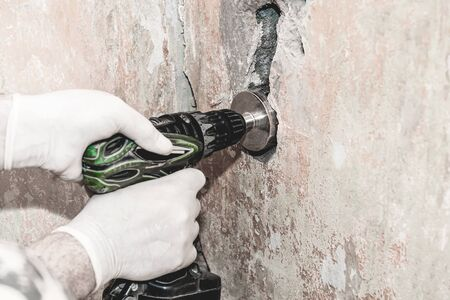 Make a hole in the wall for an electrical outlet.