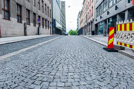 Traditional cobblestone street in Europe. Common stone street pavement in Europe.