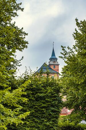 Oslo, Norway Akershus stone ancient fortress. A fragment of a building, a spire with a clock. Archivio Fotografico