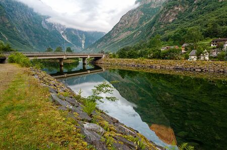 Beautiful idyllic mountain landscape. Gudvangen is a popular tourist village located at the very beginning of the Neroifjord. Bridge over the fjord.
